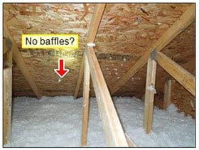 inside an attic pointing out lack of baffles