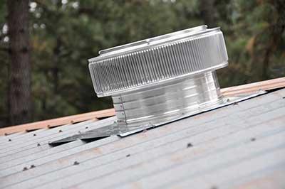 Aura Gravity Fan shown on Metal Roof