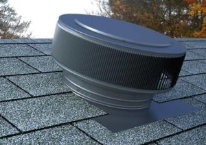 Gravity Ventilator, An Aura Roof Vent painted gray for attic ventilation
