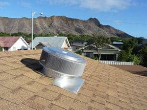 Aura roof ventilator installed on a sloped shingle roof
